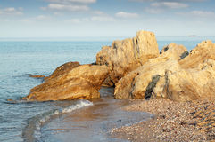 Rocky coast and ship Royalty Free Stock Photography