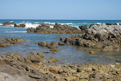 Rocky coast in south africa. Rocky coast of cape agulhas at western cape in south africa Royalty Free Stock Images