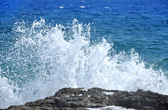 Rocky coast with splashing waves Stock Photo