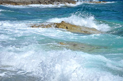Rocky coast with splashing waves Stock Image