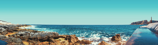 Rocky coast at St Julians. In retro style, Malta, EU Royalty Free Stock Photography