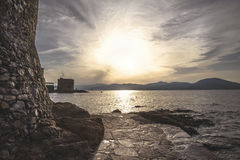 Rocky coast at sunset Stock Photography