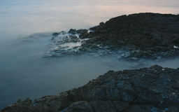 Rocky coast after sunset in the evening in Croatia Royalty Free Stock Photography
