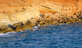 Rocky coast at sunset Royalty Free Stock Photos