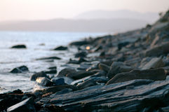 rocky coast at sunset Royalty Free Stock Photography