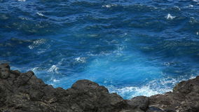 Rocky Coast and Tropical Waters. Looking down on the rocky coast in Maui, Hawaii stock video