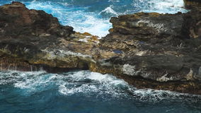 Rocky Coast and Tropical Waters. Looking down on the rocky coast in Maui, Hawaii stock footage