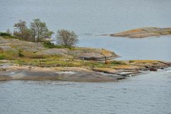 Rocky coast of uninhabited island in Baltic Sea. Aland Islands. Autumn Royalty Free Stock Photos