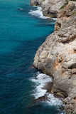 Rocky coast. View of the rocky coast and azure sea water stock photos