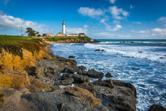 Rocky coast and view of Piegon Point Lighthouse in Pescadero, Ca Stock Photo