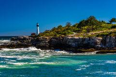 Rocky coast and view of Portland Head Light, at Fort Williams Pa Stock Photo