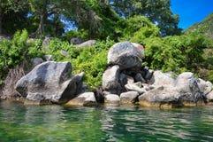 Rocky coast of the volcanic caldera Lake Coatepeque in El Salvador Royalty Free Stock Image