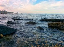 Seascape with rocky coast and wave. Sea view with rocks and waves Royalty Free Stock Photography