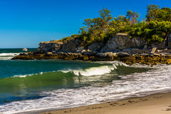 Rocky coast and waves in the Atlantic Ocean at Fort Williams Par Royalty Free Stock Photos