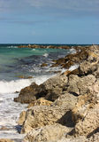 Rocky Coast. Waves crash on a rocky coast at Sand Key Park in Florida stock image