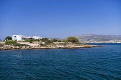Rocky coast and white houses in Antiparos island. Greece stock photo