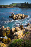 Rocky Coastal area. With mountain and deep blue ocean Royalty Free Stock Image