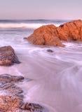 Rocky Coastal Sunrise. And Rushing Surf stock photos