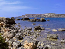 Rocky Coastline. Typical rocky coastline in Malta, punctuated with sheer drops and jagged cliffs Royalty Free Stock Images