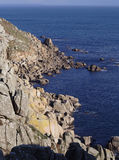 Rocky coastline. South Cornwall coastline, rocky cliffs meet deep blue sea stock photos