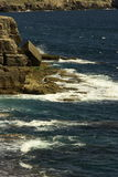 Rocky coastline. View of waves crashing on rocky coastline Royalty Free Stock Images