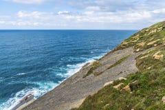 Rocky coastline along cliffs in Santander, Spain Stock Images