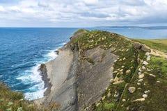 Rocky coastline along cliffs in Santander, Spain Royalty Free Stock Image
