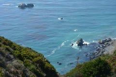 Big Sur Central Coast California gorgeous coastline. Rocky coastline with aqua blue pacific ocean and scenic coastal highway 1. stone work half domes guard rail Royalty Free Stock Photo