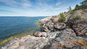 Rocky coastline at the Baltic sea. Panorama view of the rocky coastline at the Baltic sea from Grisslehamn, Sweden Royalty Free Stock Image