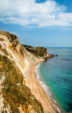 Rocky Coastline and Beach. This rocky coastline and beach is  part of Durdle Door, found on beautiful Jurassic coast, in the South of England Stock Images