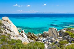 Rocky coastline and a beautiful clear water Royalty Free Stock Images