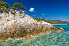 Rocky coastline and a beautiful clear water Stock Photography