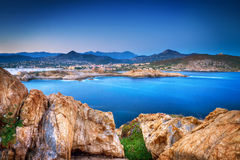 Rocky coastline and blue sea Stock Image