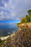 Rocky Coastline at Cave Point Stock Photos