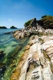 Rocky coastline with clear water at Kapas Island, Terangganu Malaysia. Royalty Free Stock Photo
