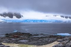 Rocky coastline fjord panorama with mountains, clouds and blue g