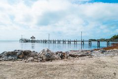 Rocky Coastline of the Florida Keys. Pier and Rocky Coastline of the Florida Keys Royalty Free Stock Image