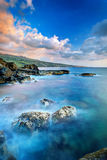Rocky coastline and fog Stock Images