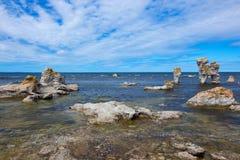 Rocky coastline in Gotland, Sweden. Rocky coastline, Fårö island in Gotland, Sweden. These cliffs are locally known as  raukar Stock Photos