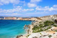 View of the rocky coastline at Paradise Bay, Malta. Rocky coastline with hotels to the rear, Paradise Bay, Malta, Europe Stock Photo