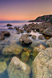 Rocky Coastline in Ireland. Sunset over rocky shore in Howth Peninsula, Republic of Ireland, Europe Stock Photo