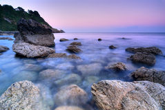 Rocky Coastline in Ireland. Sunset over rocky shore in Howth Peninsula, Republic of Ireland, Europe Stock Image