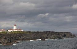 Rocky coastline landscape with lighthouse in Pico. Ponta da Ilha Stock Image