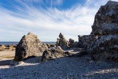 Raukar on Gotland, Baltic sea, Sweden. Rocky coastline with limestone cliffs raukar island in  Gotland, Sweden. Rocky coastline with limestone. Baltic sea Stock Photo
