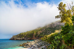 Rocky coastline with low clouds in Sicily Royalty Free Stock Photography