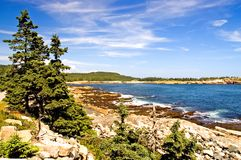 Rocky coastline of Maine. A view of the beautiful rocky coastline of Maine  with blue water and sky, near Schoodic Point, part of Acadia National Park, on a Stock Image