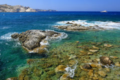 Rocky coastline of Milos island Royalty Free Stock Photos