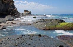 Rocky coastline near Aliso Beach in Laguna Beach, California. Image shows the rocky coastline just south of Aliso Beach in Laguna Beach, California.Conglomerate stock photography