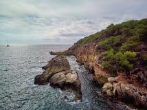 Rocky coastline near Cala Falco beach in the south-west of Mallorca. Spain. Aerial view of rocky cliffy coastline and Mediterranean Sea near Cala Falco pretty stock photo