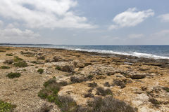 Rocky coastline next to Paphos, Cyprus Royalty Free Stock Images